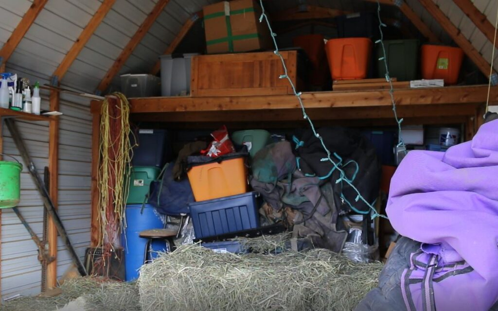 a very cluttered and messy barn