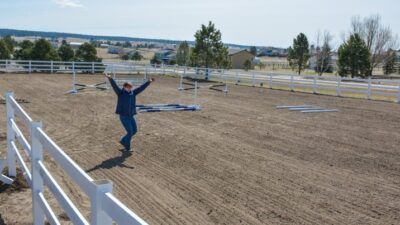 standing in a riding arena