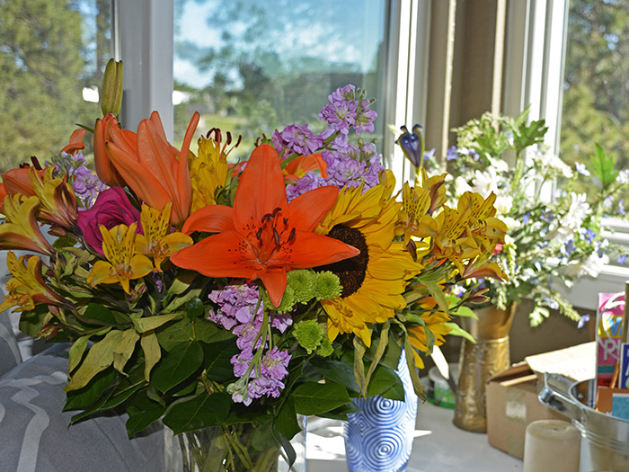 a floral arrangement in a window sill