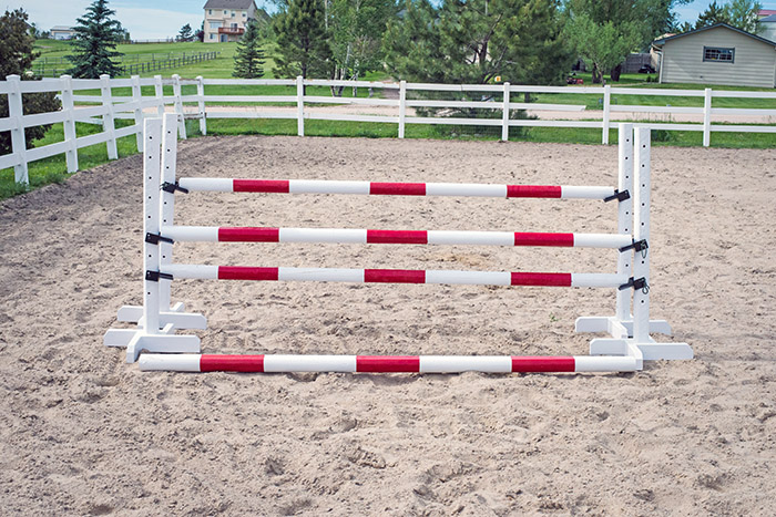 a homemade horse jump set up in an arena