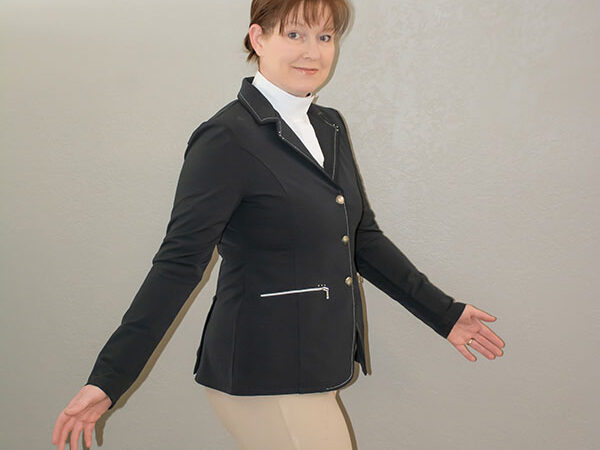 a woman in an English riding coat
