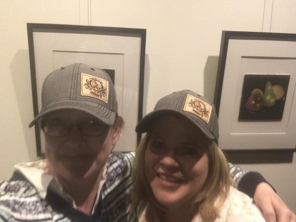 two women wearing hats