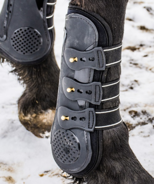 close up of open front boots for horse
