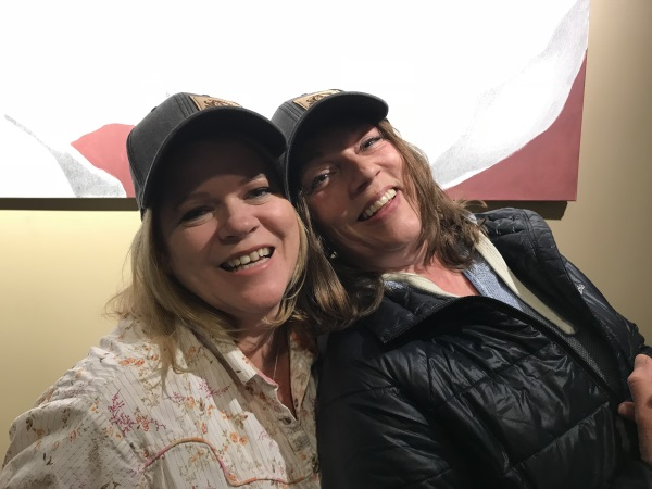 two women wearing hats and smiling