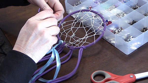 adding ribbon tails to a cream catcher