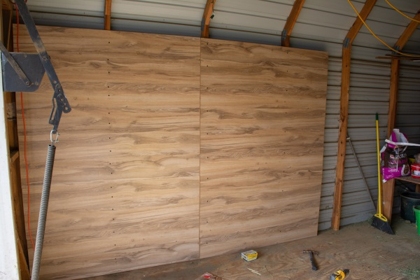 wood flooring being used on a wall in a barn