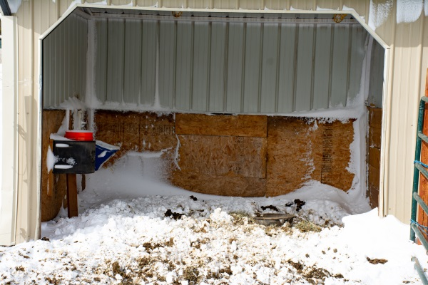 a stall filled with snow