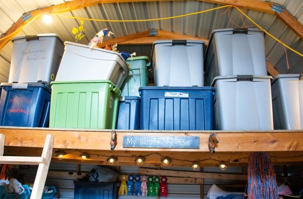 storage bins in a loft of a barn