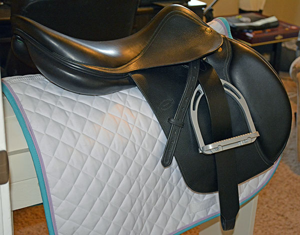 A Devoucoux saddle with Total Saddle Fit Stirrup leathers
