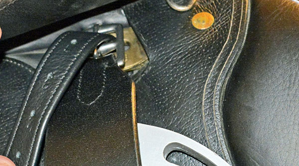 close up of a stirrup leather on an Devoucoux saddle