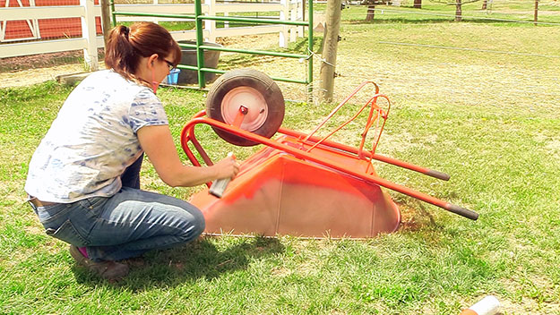 spray painting a wheelbarrow