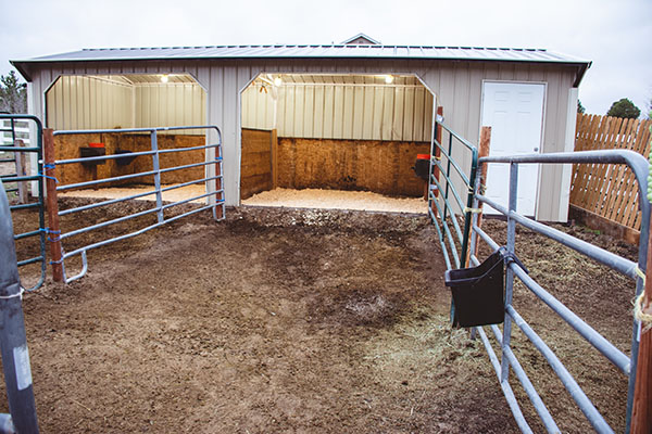a small two stall run in barn with attached runs for horses