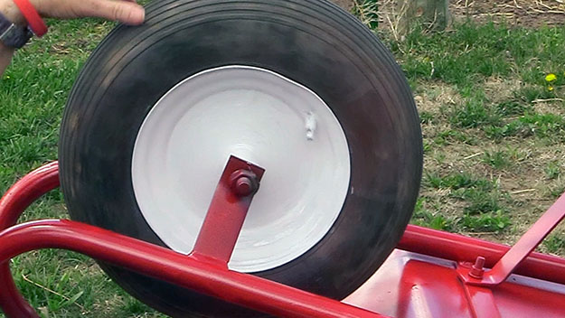 painting a wheelbarrow tire rim