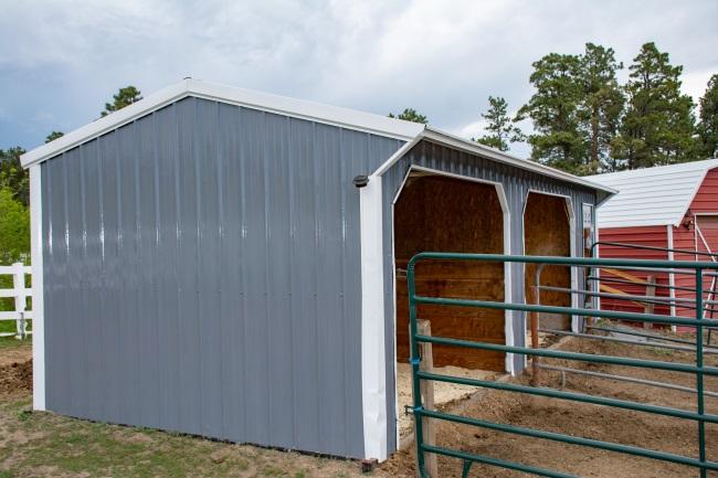 a metal horse barn