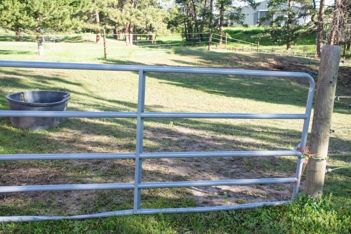 a gate in a pasture