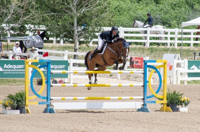a jumper ridr going over a jump