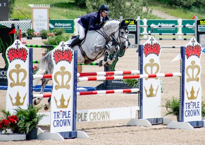 a triple crown sponsored horse jump
