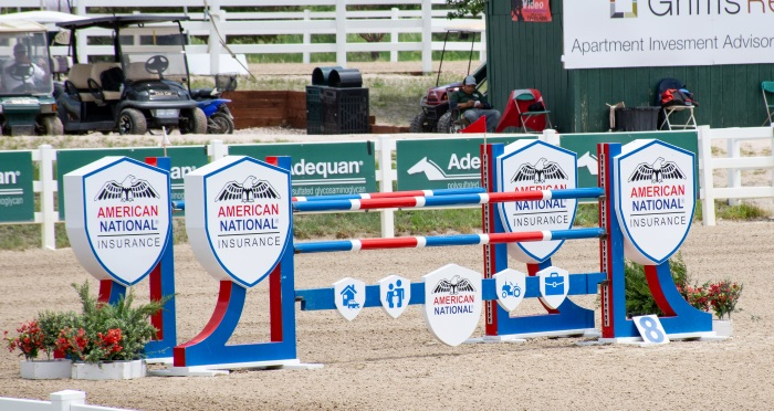 a grand prix horse jump in red and blue