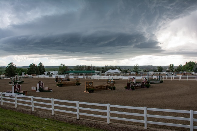 storms over a riding arena