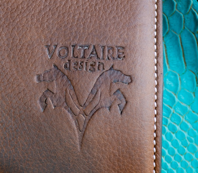 Voltaire design logo on leather