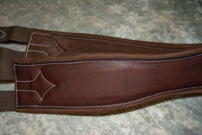 The stitching of a Voltaire Design hunter girth