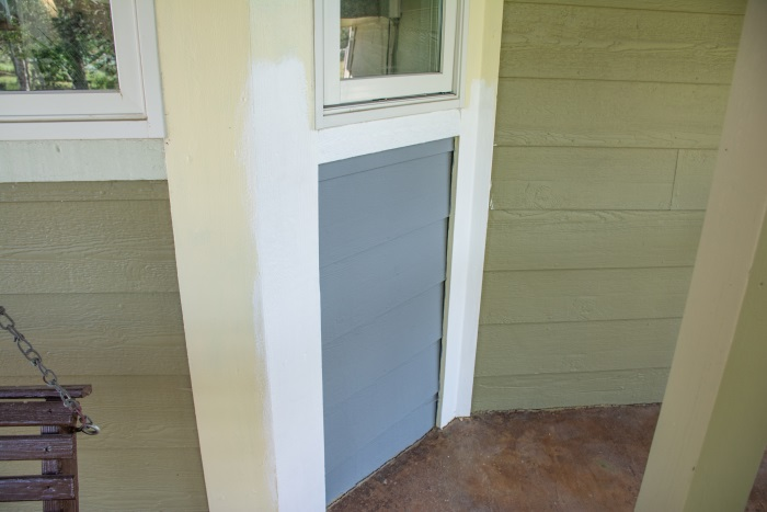 trying out sample paint colors on a house