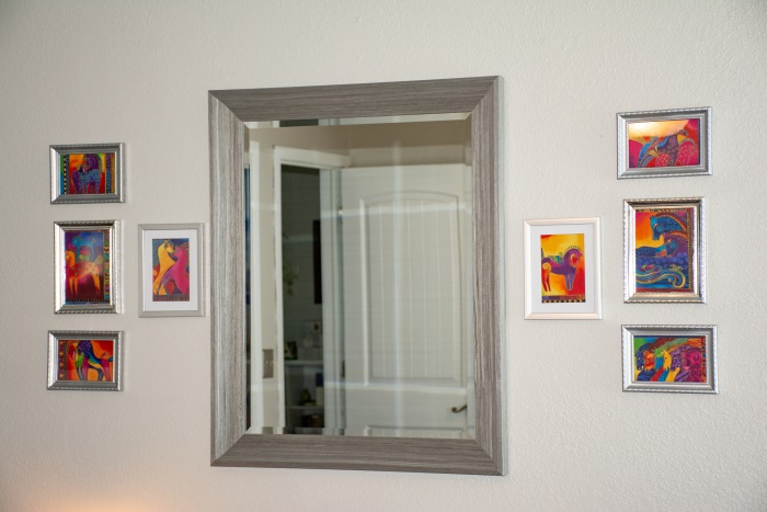 small art pictures framing a mirror