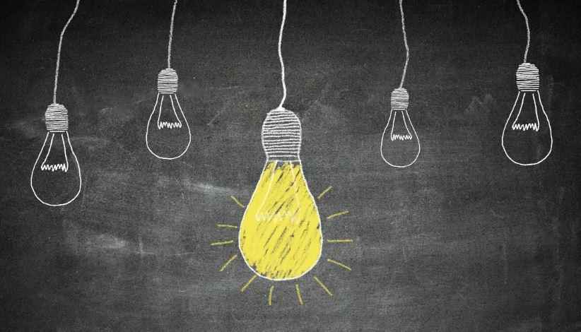 light bulbs drawn on a chalk board