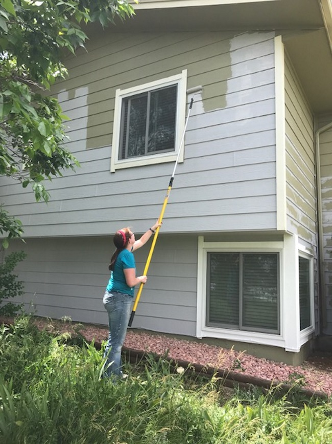 painting a house with a pole extender