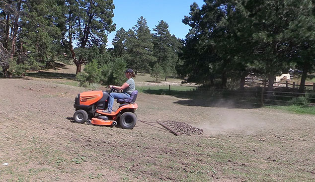 riding lawnmower with a drag hooked up